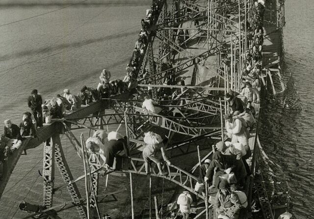 Public Domain https://commons.wikimedia.org/wiki/File:Flight_of_Refugees_Across_Wrecked_Bridge_in_Korea.jpg
